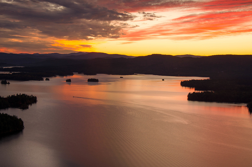 Sunset's fiery glow reflects in Squam Lake.