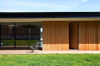 The property has been constructed in concrete and clad with natural pine