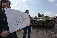 "Ukrainian forces are being blocked by local citizens near Kramatorsk city during the anti-terrorist operation. The banner reads: ""make no war"""