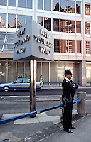 Police officer on duty outside Metropolitan Police Headquarters New Scotland Yard 10 Broadway London SW1. This image may only be used to portray the subject in a positive manner..©shoutpictures.com..john@shoutpictures.com