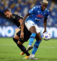 Marko Pjaca of Genoa CFC and Victor Osimhen of SSC Napoli compete for the ball during the Serie A football match between SSC Napoli and Genoa CFC at San Paolo stadium in Napoli (Italy), September 27th, 2020. Photo Cesare Purini / Insidefoto