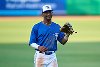 Dunedin Blue Jays outfielder Justin Ammons (3) takes the field while joking with teammates during a game against the Bradenton Marauders on May 15, 2021 at BayCare Ballpark in Clearwater, Florida.  (Mike Janes/Four Seam Images)