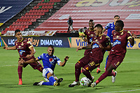 IBAGUE - COLOMBIA, 06-10-2020: Daniel Cataño del Tolima comete penal sobre Jhon Duque Arias de Millonarios durante partido entre Deportes Tolima y Millonarios por la fecha 12 de la Liga BetPlay DIMAYOR 2020 jugado en el estadio Manuel Murillo Toro de la ciudad de Ibagué. / Daniel Cataño of Tolima commits a penalty on Jhon Duque Arias of Millonarios during match between Deportes Tolima and Millonarios for the date 12 as part BetPlay DIMAYOR League 2020 played at Manuel Murillo Toro stadium in Ibague city.  Photo: VizzorImage / Joan Stiven Orjuela / Cont