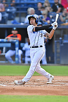 Asheville Tourists Shay Whitcomb (9) swings at a pitch during a game against the Greenville Drive on July 14, 2021 at McCormick Field in Asheville, NC. (Tony Farlow/Four Seam Images)