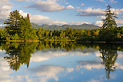 View of mountains from Coffin Pond in Sugar Hill, New Hampshire USA during the spring months.
