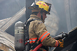 A firefighter holding a hose