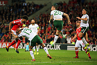 (L-R) Ashley Williams of Wales takes a header against Jeff Hendrick and Shane Duffy of Ireland during the FIFA World Cup Qualifier Group D match between Wales and Republic of Ireland at The Cardiff City Stadium, Wales, UK. Monday 09 October 2017