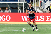 FOXBOROUGH, MA - AUGUST 29: Henry Kessler #4 of New England Revolution dribbles at midfield during a game between New York Red Bulls and New England Revolution at Gillette Stadium on August 29, 2020 in Foxborough, Massachusetts.