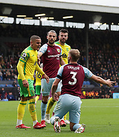 2nd October 2021;  Turf Moor, Burnley, Lancashire, England; Premier League football, Burnley versus Norwich City: Max Aarons of Norwich City remonstrates with Charlie Taylor of Burnley after he went down under a challenge in the penalty area