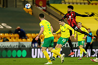 17th April 2021; Carrow Road, Norwich, Norfolk, England, English Football League Championship Football, Norwich versus Bournemouth; Philip Billing of Bournemouth wins a header against Kenny McLean of Norwich City