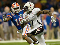 01 January 2010:  Mardy Gilyard of Cincinnati runs the ball during the game against Florida during Sugar Bowl at the SuperDome in New Orleans, Louisiana.  Florida defeated Cincinnati, 51-24.