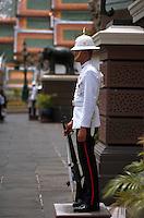 A guard at the steps to the Grand Palace in Bangkok, Thailand