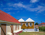 Anguilla, BWI<br /> Colorful buildings under a blue sky in Anguilla's Crocus Hill neighborhood