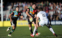 Nick Easter of Harlequins passes as Danny Care of Harlequins supports during the Aviva Premiership Rugby match between Harlequins and London Irish at The Twickenham Stoop on Saturday 7th March 2015 (Photo by Rob Munro)