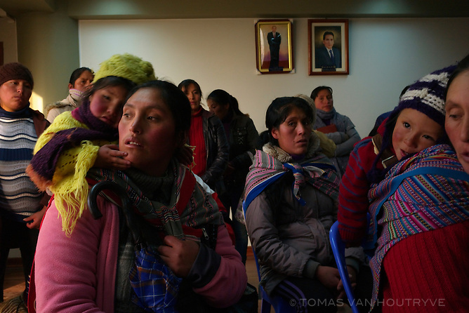 Citizens concerned about contamination from mining activity in Cerro de Paco, Peru attend a meeting at the city hall of Rancas on June 6, 2013. Community leaders and representatives of school classes attended the meeting with municipal environmental authorities and a technician from OEFA, the Peruvian state environmental evaluation organization. OEFA planned to test the air, water and soil of Cerro de Pasco. Front left is Lisbeth Vivar Porras, middle second row is Nely Carbajal Ponce, front right is Olinda Daga Inocente.