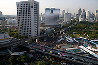 The corner of Lumpini Park in Bangkok and the inersection with Rama IV road and Silom Bangkok's business district. Below is the barricades and occupated area under the control of the Red Shirt protestors. Bangkok, Thailand.