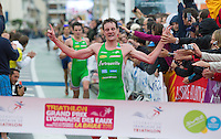 17 SEP 2011 - LA BAULE, FRA - Alistair Brownlee  races down the finish straight to cross the line first just ahead of team mate and brother Jonathan Brownlee during the final round of the French Grand Prix Series triathlon in La Baule, France. The Brownlee's EC Sartrouville team retained the title after winning every round of the 5 race series which is based on a team format with points awarded for the finish position of each of the first three team members .(PHOTO (C) NIGEL FARROW)