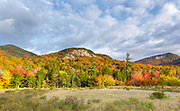 Autumn foliage along the Kancamagus Highway (route 112), which is one of New England's scenic byways in the White Mountains, New Hampshire USA. Table Mountain is on the right.