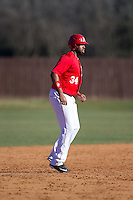 Leighton Gibson (34) of the Belmont Abbey Crusaders takes his lead off of second base against the Shippensburg Raiders at Abbey Yard on February 8, 2015 in Belmont, North Carolina.  The Raiders defeated the Crusaders 14-0.  (Brian Westerholt/Four Seam Images)
