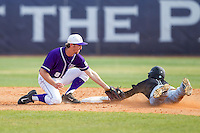 High Point Panthers shortstop Tony Fortier-Bensen (8) applies the tag to Michael Paez (1) of the Coastal Carolina Chanticleers as he tries to steal second base at Willard Stadium on March 15, 2014 in High Point, North Carolina.  The Chanticleers defeated the Panthers 1-0 in the first game of a double-header.  (Brian Westerholt/Four Seam Images)