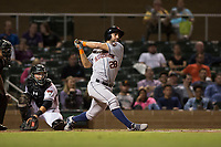 Scottsdale Scorpions third baseman Abraham Toro (28), of the Houston Astros organization, follows through on his swing in front of catcher Daulton Varsho (8) during an Arizona Fall League game against the Salt River Rafters at Salt River Fields at Talking Stick on October 11, 2018 in Scottsdale, Arizona. Salt River defeated Scottsdale 7-6. (Zachary Lucy/Four Seam Images)