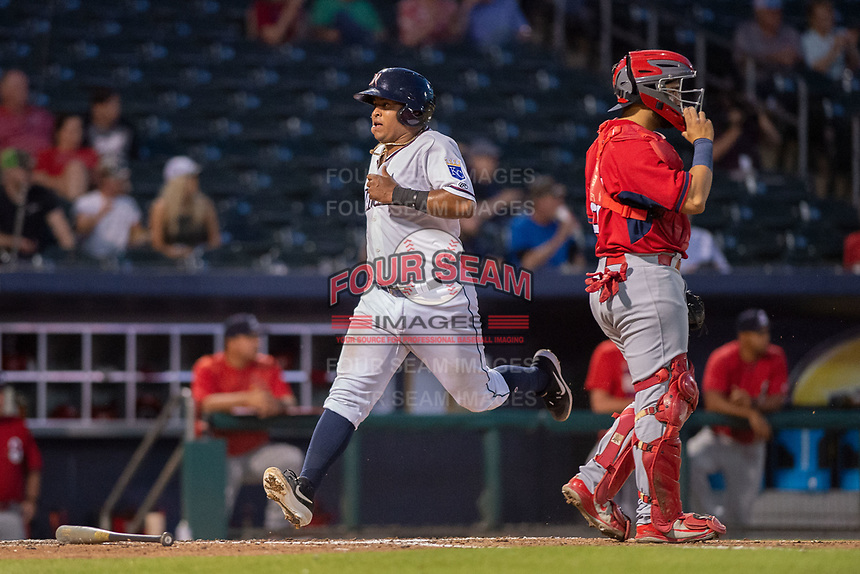 Northwest Arkansas Naturals catcher Meibrys Viloria (22) crosses the plate for a run on May 16, 2019, at Arvest Ballpark in Springdale, Arkansas. (Jason Ivester/Four Seam Images)