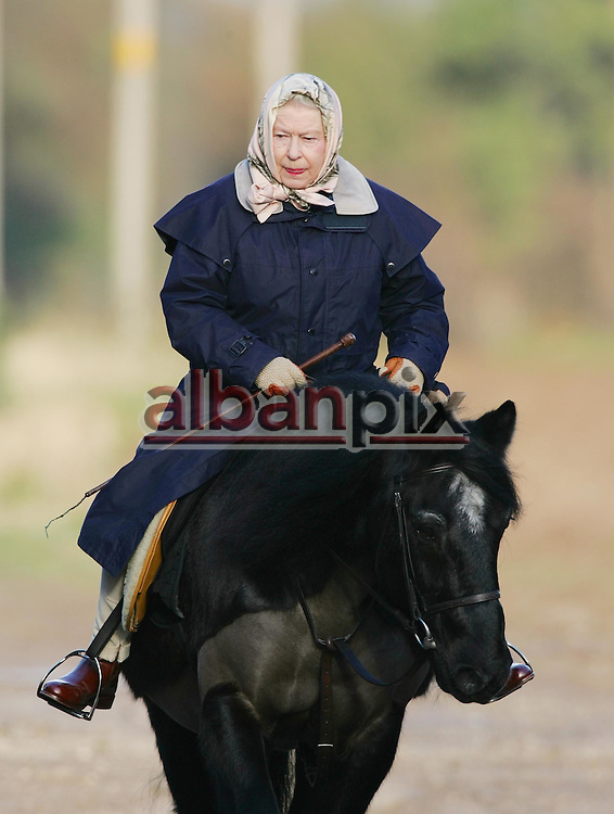 ©ALBANPIX .COM -Picture BY Alban Donohoe.The Queen out riding on the Sandringham Est, Norfolk 3/1/05.