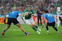 Jamie Heaslip of Ireland charges into Matias Aguero and Tommaso Allan of Italy during Match 28 of the Rugby World Cup 2015 between Ireland and Italy - 04/10/2015 - Queen Elizabeth Olympic Park, London<br /> Mandatory Credit: Rob Munro/Stewart Communications