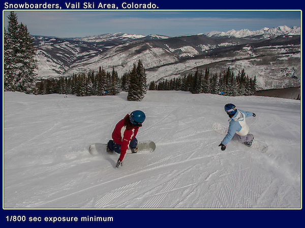Young women snowboarding in Blue Sky Basin at Vail Ski Area, Colorado. <br /> Outside Imagery offers ski taxi to Vail Ski Area from Denver International Airport (DIA).
