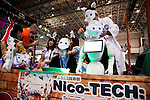 """A SoftBank robot Pepper performs at the Niconico Douga fan event in Makuhari Messe International Exhibition Hall on April 25, 2015, Chiba, Japan. The event includes special attractions such as J-pop concerts, Sumo and Pro Wrestling matches, cosplay and manga and various robot performances and is broadcast live on via the video-sharing site. Niconico Douga (in English """"Smiley, Smiley Video"""") is one of Japan's biggest video community sites where users can upload, view, share videos and write comments directly in real time, creating a sense of a shared watching. According to the organizers more than 200,000 viewers for two days will see the event by internet. The popular event is held in all 11 halls of the huge Makuhari Messe exhibition center from April 25 to 26. (Photo by Rodrigo Reyes Marin/AFLO)"""