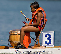 A woman leads the cadence during the Charlotte Dragonboat Association racing on Lake Norman in NC.