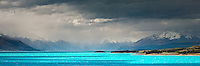 Glacial turquoise waters of Lake Pukaki near Aoraki, Mt. Cook Village and moody weather, Mackenzie Country, Canterbuty, South Island, New Zealand, NZ