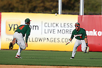 """A ball drops in between Miami Hurricanes Nathan Melendres #10 and Stephen Perez #4 during a game vs. the University of South Florida Bulls in the """"Florida Four"""" at George M. Steinbrenner Field in Tampa, Florida;  March 1, 2011.  USF defeated Miami 4-2.  Photo By Mike Janes/Four Seam Images"""