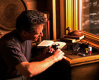 A fly fisherman tying flies.