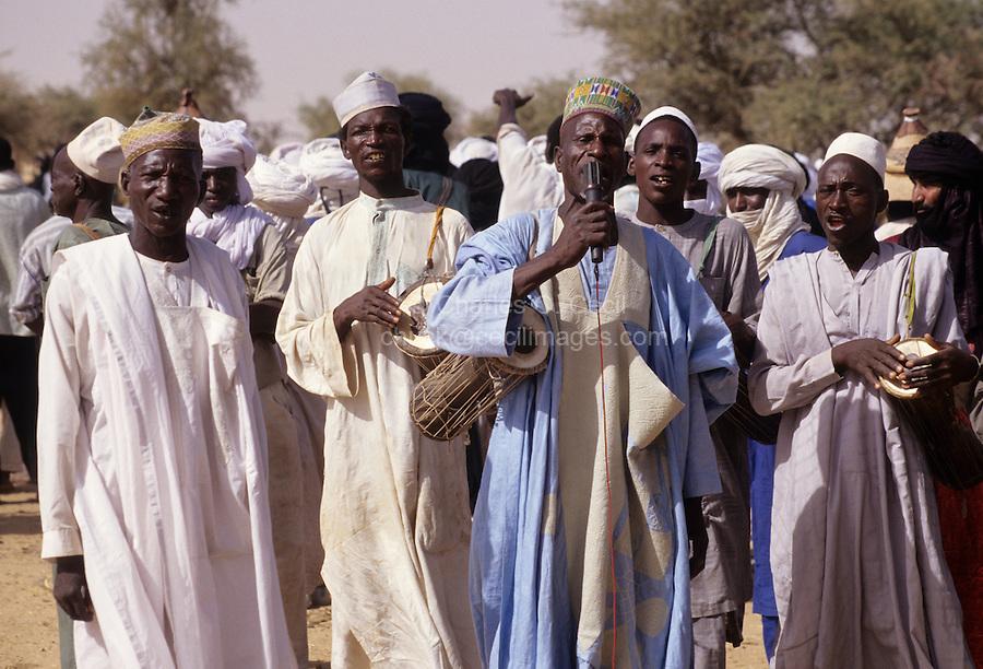 Akadaney, Central Niger, West Africa.  Fulani Nomads.   Men Singing at Annual Gathering, Geerewol.