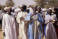 Akadaney, Central Niger, West Africa.  Fulani Nomads.   Men Singing at Annual Gathering, Geerewol.
