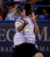 American Andy Roddick hits a forehand during the Legg Mason Tennis Classic at the William H.G. FitzGerald Tennis Center in Washington, DC.  Giles Simon defeated Andy Roddick in straight sets in a thunderstorm delayed evening session.