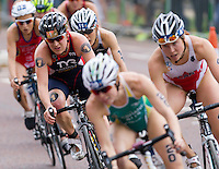 31 MAY 2014 - LONDON, GBR - Jodie Stimpson (GBR) (ENG) (second from the left, in dark blue with red and white) of Great Britain and England takes a corner during the bike at the elite women's 2014 ITU World Triathlon Series round in Hyde Park, London, Great Britain (PHOTO COPYRIGHT © 2014 NIGEL FARROW, ALL RIGHTS RESERVED)