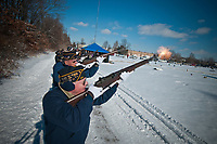 An American Legion Honor Guardsfires their weapons for a 21-gun-salute at the funeral of a World War II veteran being laid to rest at a cemetery in Westerville, Ohio. The local American Legion travels to perform the ceremony whenever requested and has traveled to adjoining states to assist other groups with their needs.
