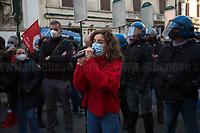 Students Representative. <br /> <br /> Rome, Italy. 18th Feb 2021. Today, the Trade Union Si Cobas, Potere Al Popolo Party, Rifondazione Comunista Party and other organizations of the non-parliamentarian Left held a rally (1.) in Piazza San Silvestro to protest against the new Italian Government led by the former President of the European Central Bank, BCE, Professor Mario Draghi (2. 3.). From the organisers Facebook event page: «[…] We call to mobilize male and female workers, the unemployed, the precarious, the students, the popular classes and all the associations and people who struggle, who do not want to stand by while a government that is directed expression of a united bosses front is ready to strike us with anti-people policies. It is time to join the fight against the government of banks and bosses: we will not pay for this crisis! […]». The demo ended peacefully, even though there were moments of tension between protesters and full riot gears police officers due to demonstrators aimed to march to the Parliament.<br /> <br /> Footnotes & Links:<br /> 1. https://www.facebook.com/events/4966336456769715<br /> 2. 13.02.2021 - Mario Draghi's New Italian Government Swears At Quirinale Palace http://bit.do/fNPQ5<br /> 3. 17.02.2021 - Italian Prime Minister Mario Draghi Arrives at Italian Senate http://bit.do/fNPRc
