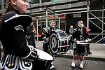 Saturday, April 14,  2007, New York, New York.. The 9th annual Tartan Day Parade was held today on 6th Avenue between 44th and 58th Streets.. Thousands turned out to play the drums, pipes and to view all those dressed for the occasion.. Sara-jo Fegley (center), of the MacKay Pipe Band of Bethlehem, PA, practices before the parade begins.