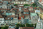 Rangoon has the highest number of colonial style buildings in SE Asia, many are in terrible condition, literally falling down. Over crowding and sanitation are wanting. Yangon Rangoon Myanmar Burma 2006.