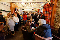 Pictured: Dozens of fans look on as Brian May (R) is interviewed in the No Sign bar. Thursday 26 December 2019<br /> Re: Guitarist Brian May of Queen has joined the Boxing Day Hunt in Wind Street, Swansea, Wales, UK.
