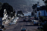 Two people cross Lansing Street in Mendocino, a scenic unincorporated community on the Pacific coast supported by artists, restaurants and bed and breakfasts. Most of the quaint town is on the National Register of Historic Places as it is filled with gingerbread, Victorian architecture. It has been featured in films such as East of Eden and was the fictional town of Cabot Cove, Maine for the tv series Murder, She Wrote.