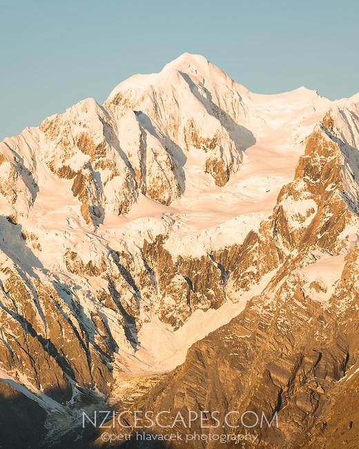 Sunset on highest peaks of Southern Alps Mount Tasman, Aoraki Mount Cook and La Perouse, Westland Tai Poutini National Park, UNESCO World Heritage Area, West Coast, New Zealand, NZ