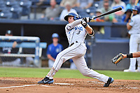 Asheville Tourists Kyle Datres (3) swings at a pitch during a game against the Rome Braves at McCormick Field on August 12, 2019 in Asheville, North Carolina. The Tourists defeated the Braves 11-6. (Tony Farlow/Four Seam Images)