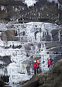 12/12/12 ..As temperatures continue to plummet, climbers Simon Stokes and Mark Davies admire  giant icicles cascading down the frozen Kinder Downfall waterfall high up in the Derbyshire Peak District...All Rights Reserved - F Stop Press.  www.fstoppress.com. Tel: +44 (0)1335 300098.