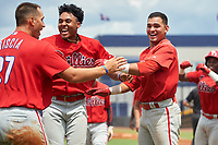 GCL Phillies East Jose Tortolero (right) celebrates with Marcus Lee Sang (center) and Vito Friscia (left) after hitting a walk-off sacrifice fly during a Gulf Coast League game against the GCL Yankees East on July 31, 2019 at Yankees Minor League Complex in Tampa, Florida.  GCL Phillies East defeated the GCL Yankees East 4-3 in the second game of a doubleheader.  (Mike Janes/Four Seam Images)