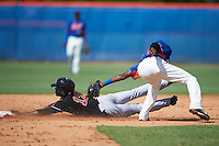 GCL Marlins outfielder Isaiah White (12) slides into second as Cecilio Aybar (39) sweeps the tag during the first game of a doubleheader against the GCL Mets on July 24, 2015 at the St. Lucie Sports Complex in St. Lucie, Florida.  GCL Marlins defeated the GCL Mets 5-4.  (Mike Janes/Four Seam Images)