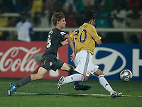 Alex Shinsky chases down the ball against Albert Dalmau (20). Spain defeated the U.S. Under-17 Men National Team  2-1 at Sani Abacha Stadium in Kano, Nigeria on October 26, 2009.